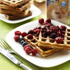 Almond waffles with berry compote